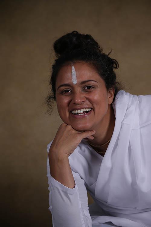 Yoga docent Charadha Primkoemarie
